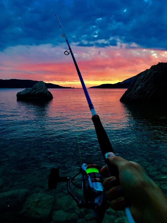 Pesca no crepúsculo fotografia de stock