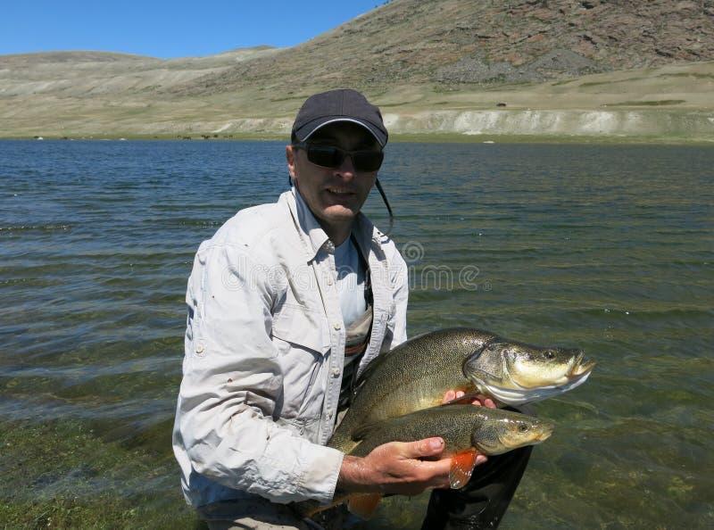Pesca - osman mongolo fotografie stock libere da diritti