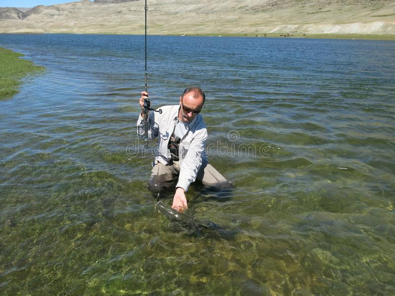 Pesca - osman mongolo fotografie stock