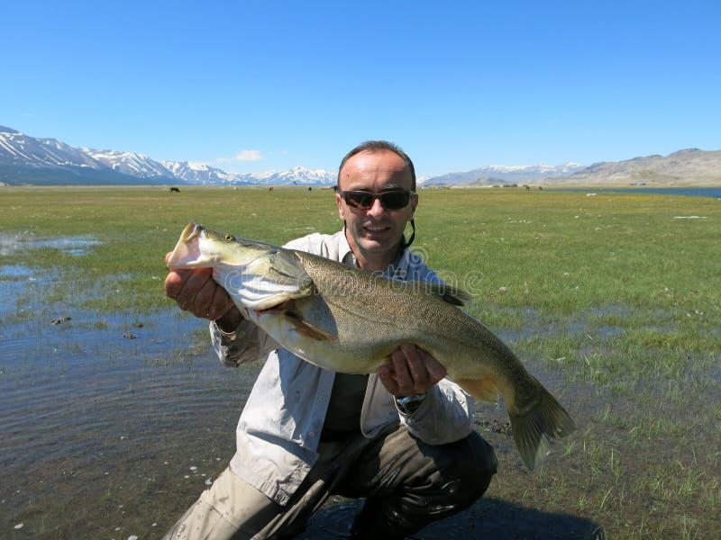Pesca - osman mongolo immagini stock