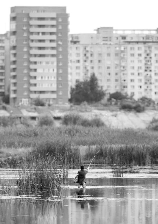 Pesca urbana foto de archivo
