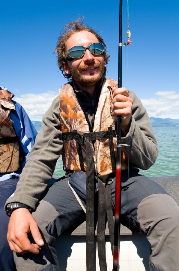 Pescador alegre imagen de archivo libre de regalías
