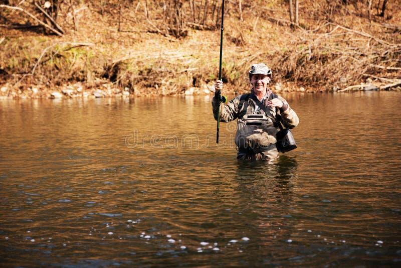 Download Pescador Alegre Que Mantém Um Timalo Travado Imagem de Stock - Imagem de passatempo, pescador: 80100007