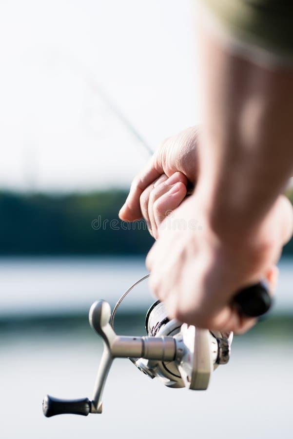 Pescador com vara de pesca à disposição fotos de stock royalty free