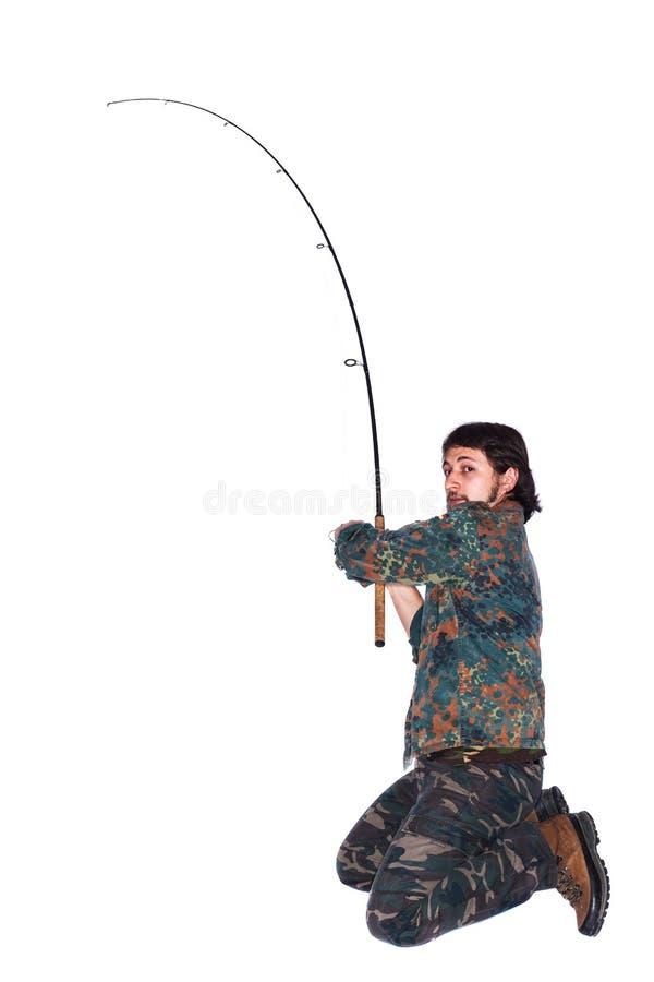 Pescador con la barra de pesca imagenes de archivo
