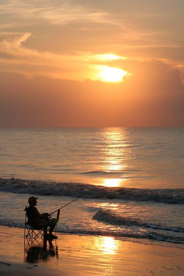Pescador de la playa de Carolina foto de archivo