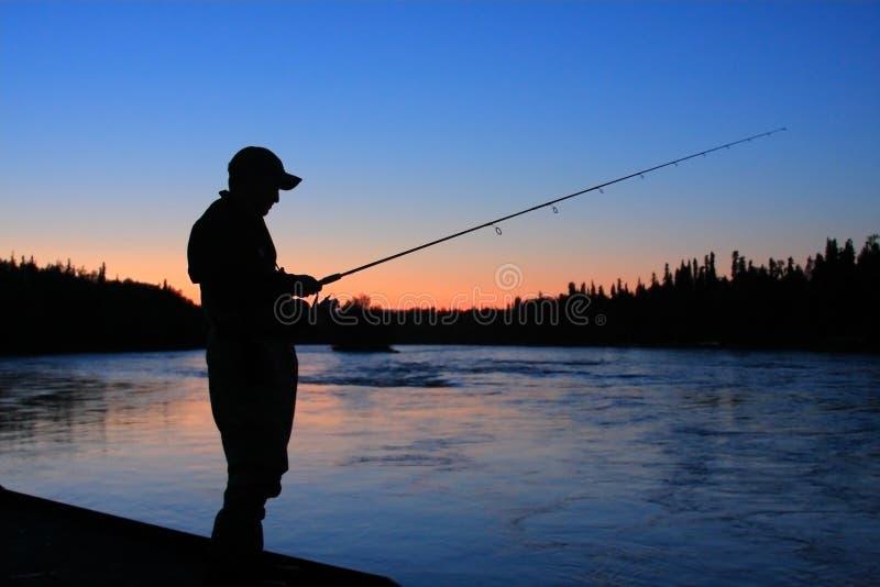 Pescador de Sillouette fotografía de archivo libre de regalías