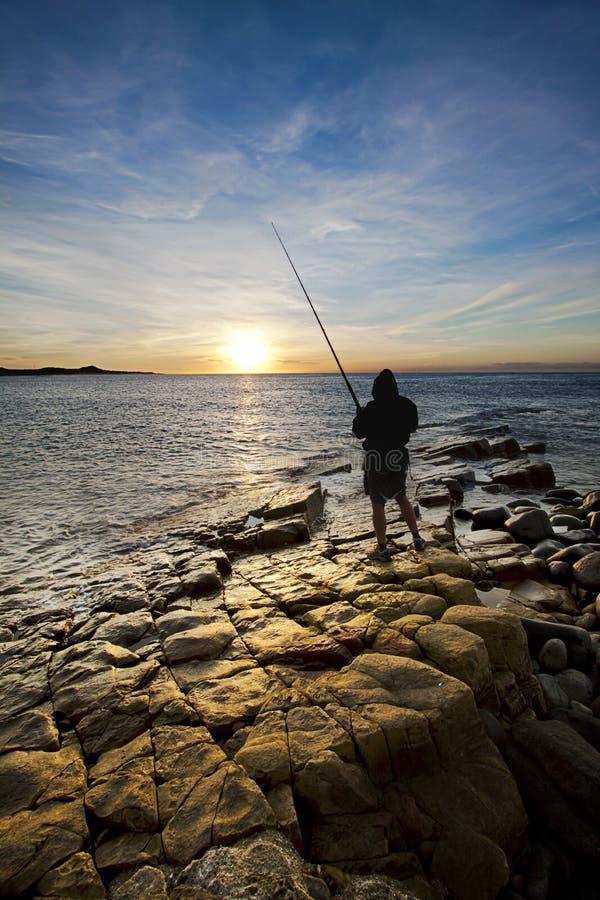 Pescador do nascer do sol imagens de stock royalty free