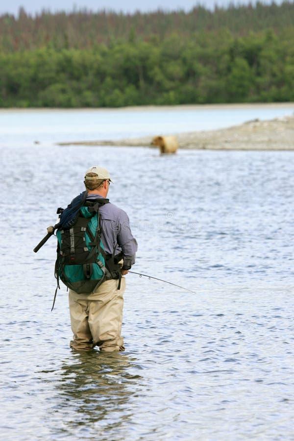 Pescador e urso fotos de stock