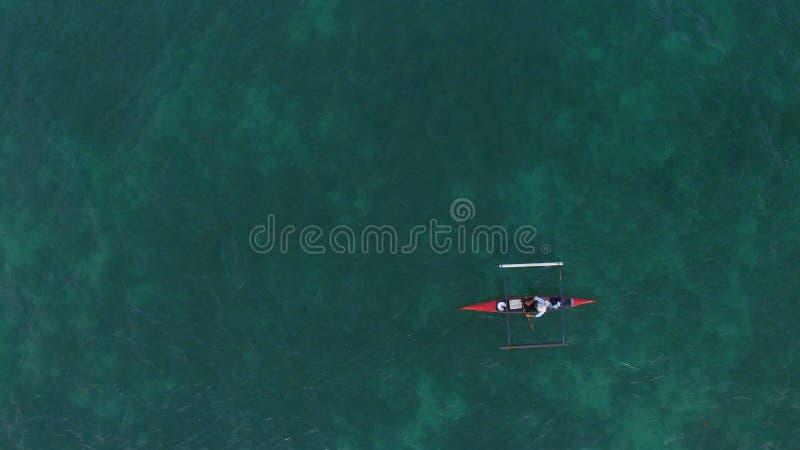 Pescador en la playa imagen de archivo libre de regalías