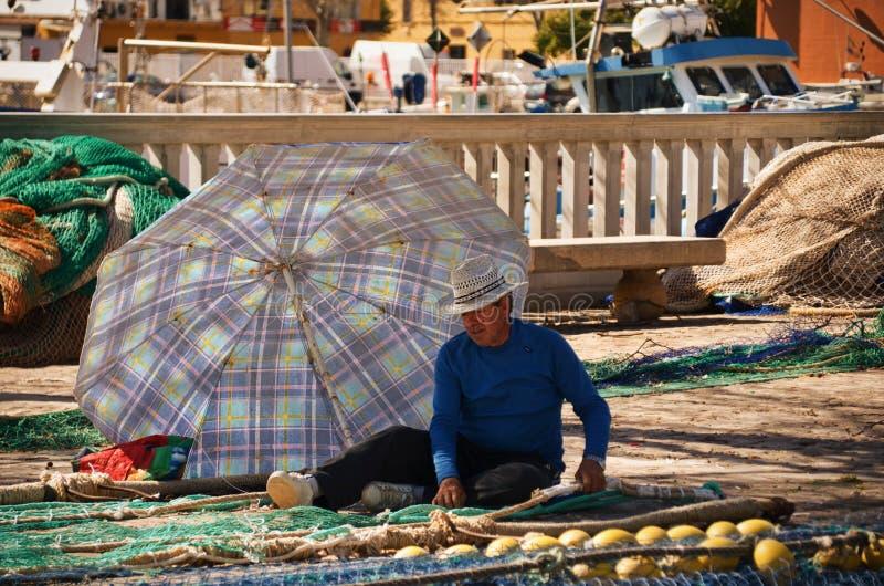 Pescador en Palma de Mallorca imagen de archivo