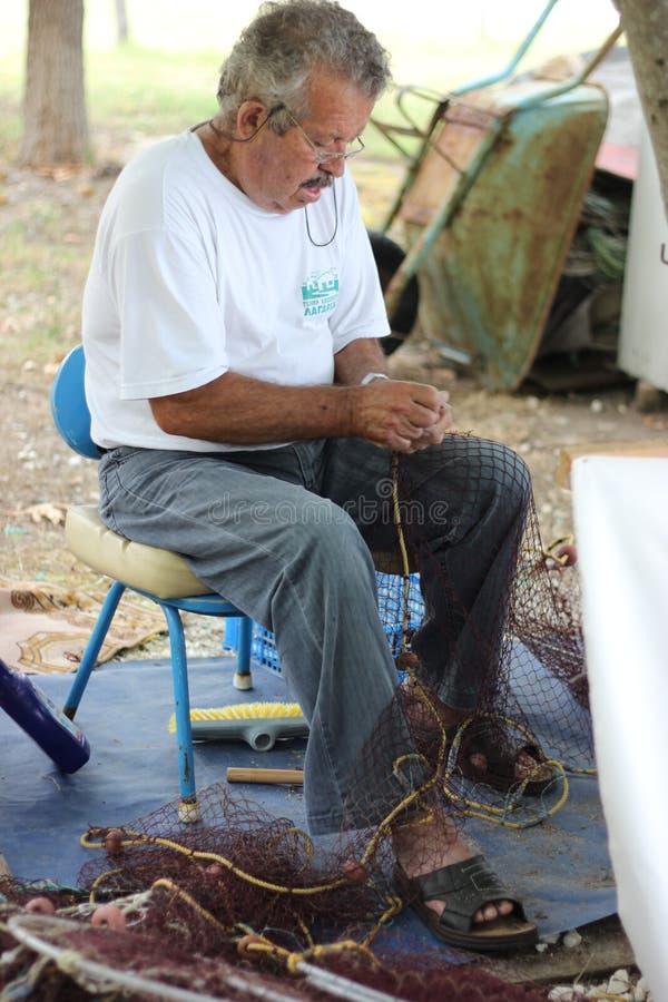 Pescador idoso foto de stock