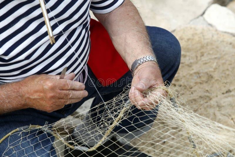 Pescador Mending Nets foto de archivo libre de regalías