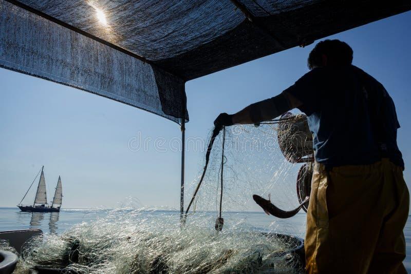 Pescador no mar foto de stock royalty free