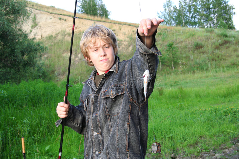 Pescador novo foto de stock royalty free