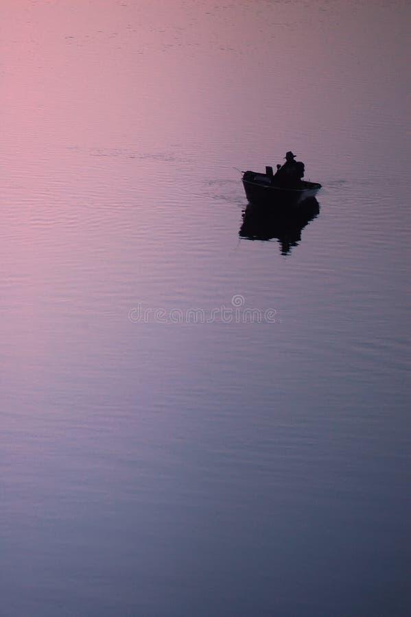 Pescador solitario fotografía de archivo