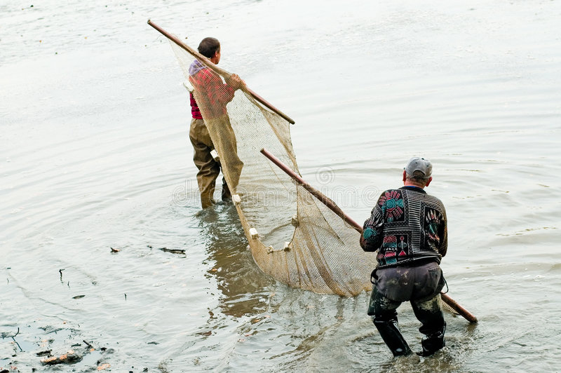 Pescadores durante o trabalho imagem de stock royalty free