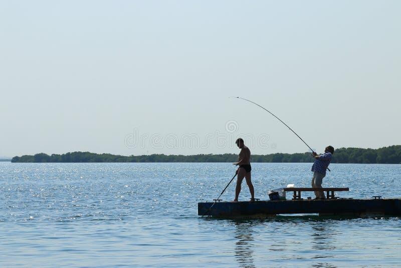 Pescadores en el embarcadero imágenes de archivo libres de regalías