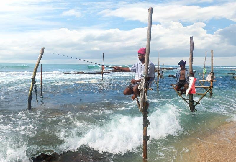 Pescadores en el palillo fotos de archivo libres de regalías