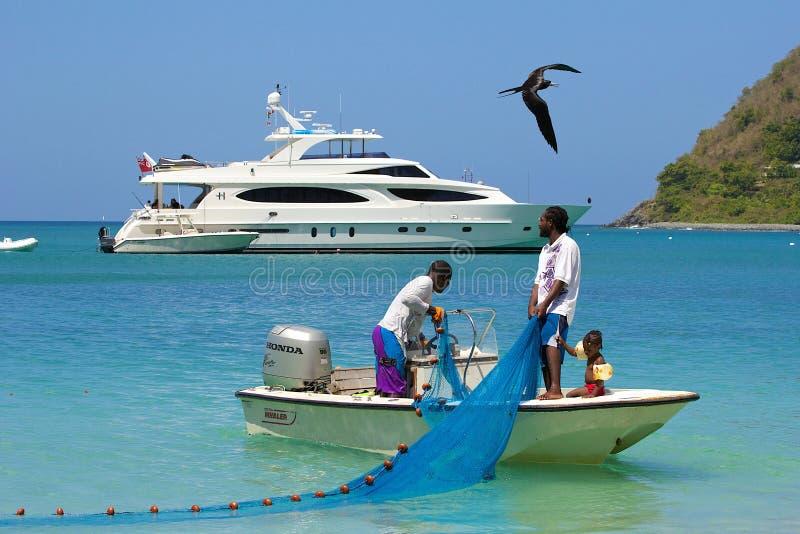 Pescadores en Tortola, del Caribe fotografía de archivo