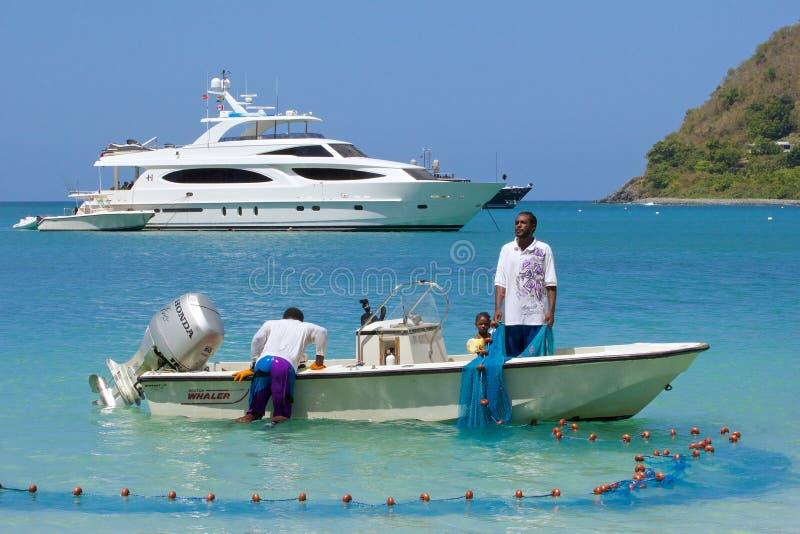 Pescadores en Tortola, del Caribe fotos de archivo