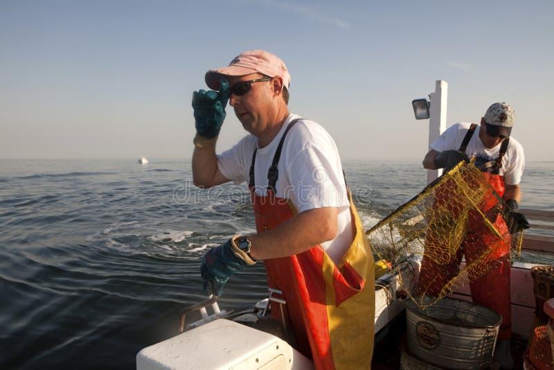 Pescadores no mar foto de stock royalty free