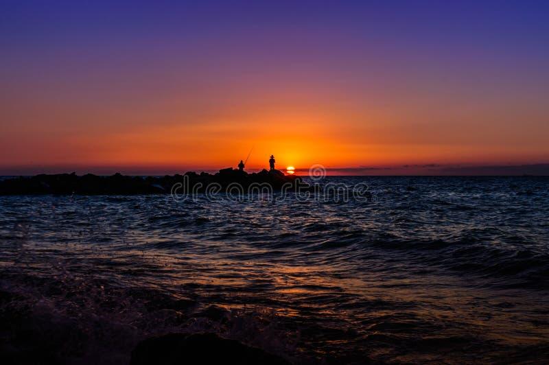 Pescadores no por do sol macio imagens de stock royalty free
