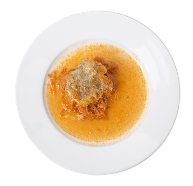 Pescados hervidos con la salsa de la zanahoria imagen de archivo