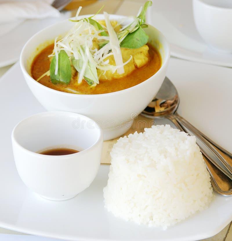Pescados y arroz foto de archivo