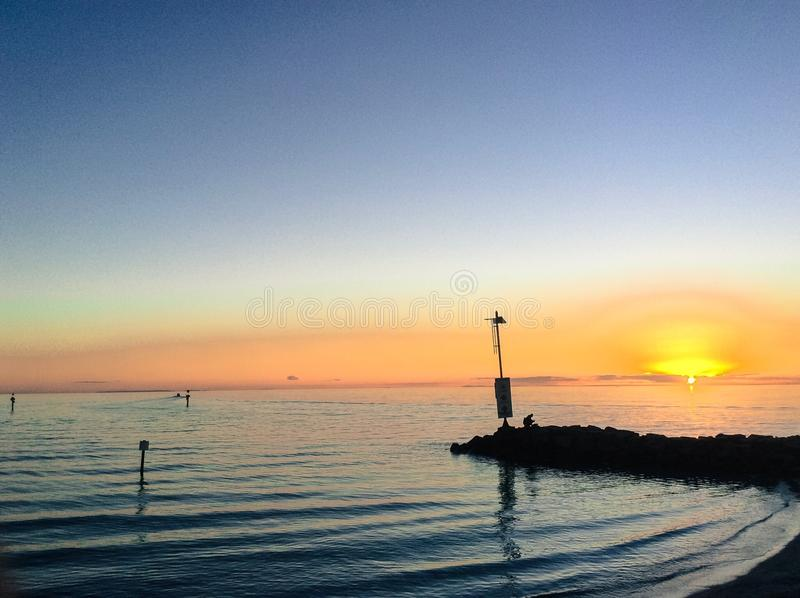 Pescando al tramonto fotografia stock libera da diritti