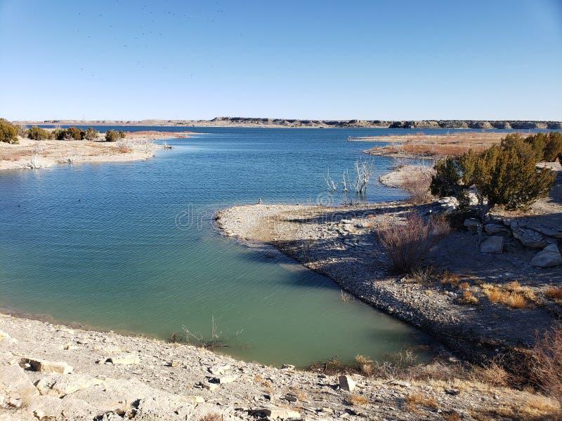 Pescando dal lago immagini stock