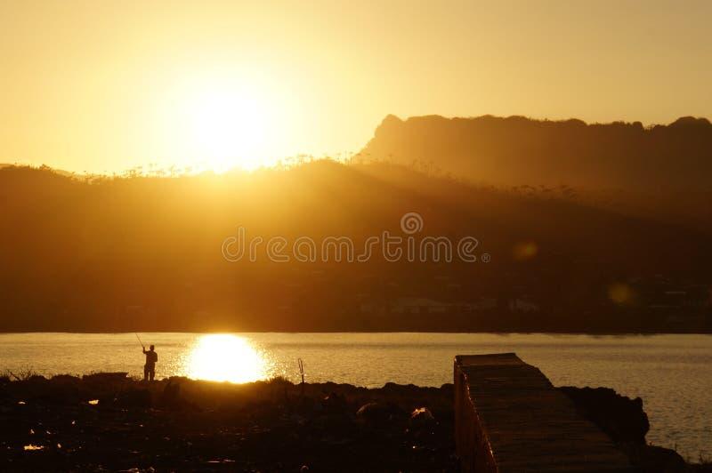 Pescando en la puesta del sol, Baracoa imágenes de archivo libres de regalías