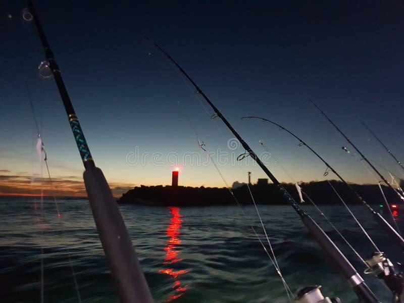 Pescando o amanhecer da carta patente imagens de stock royalty free