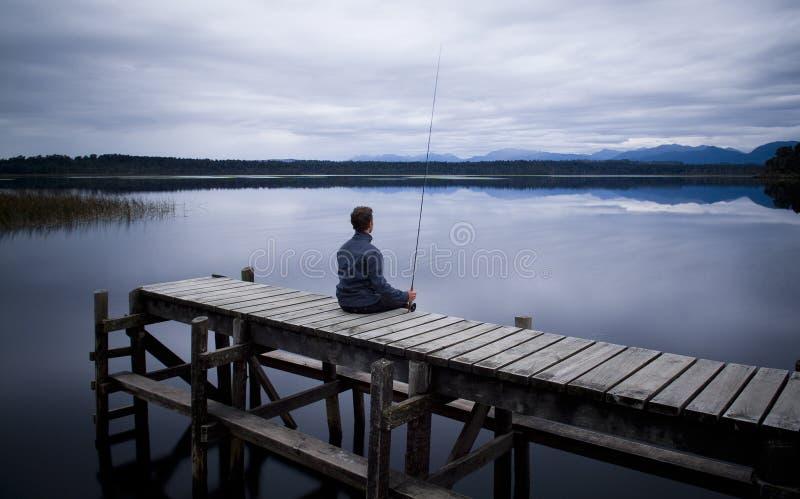 Pescatore di inverno immagine stock