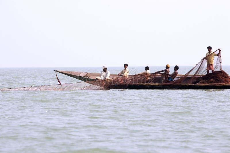 Pescatore indiano sul lago Chilika fotografia stock
