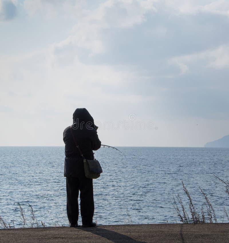 Pescatore sul lago Baikal fotografia stock libera da diritti