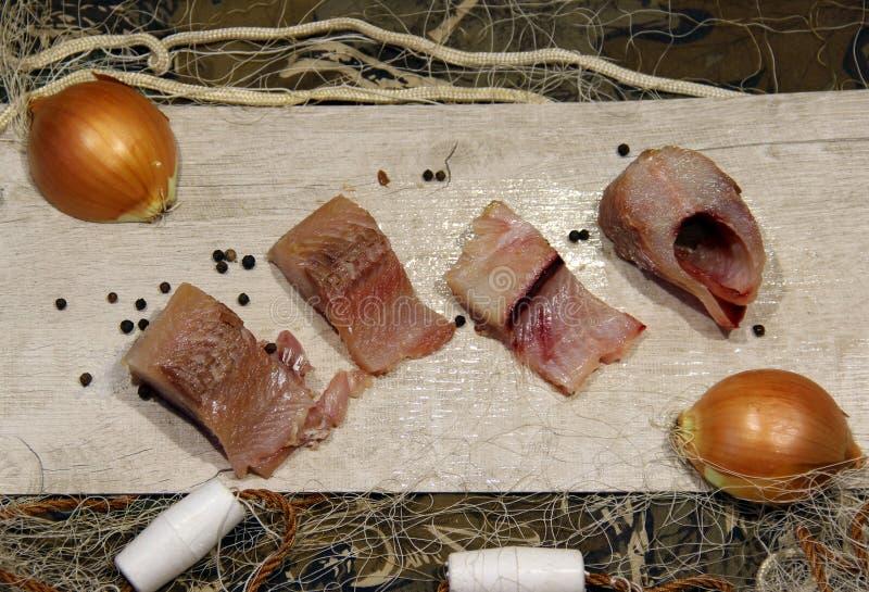 Pesce salato cucinato dopo il fermo fotografie stock