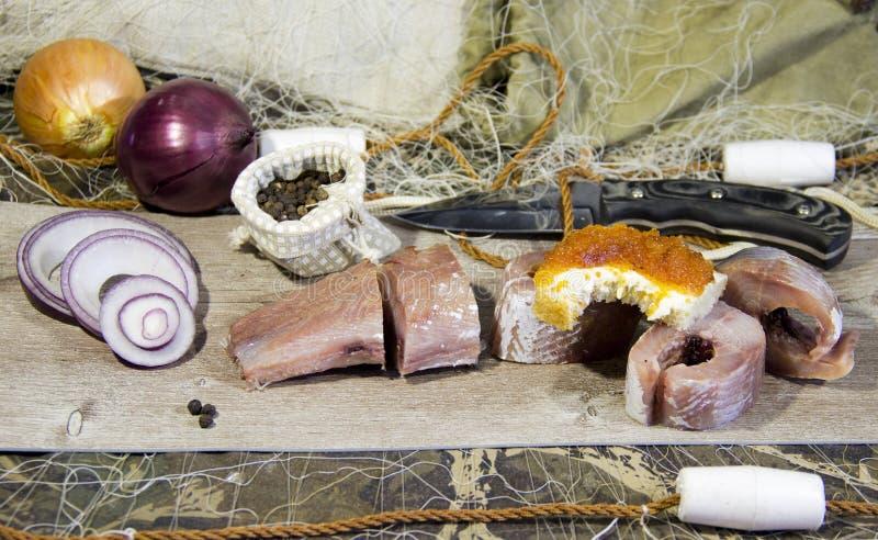 Pesce salato cucinato dopo il fermo immagine stock libera da diritti