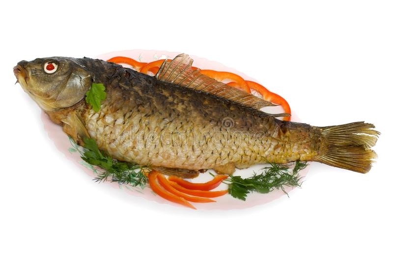 Peschi, carpa farcita con i pesci tritati e verdure fotografie stock libere da diritti