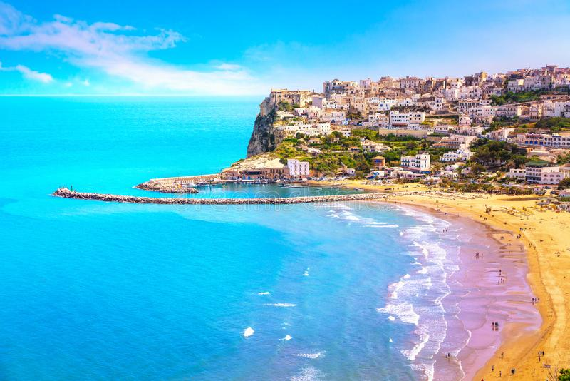 Peschici village and beach, Gargano peninsula, Apulia, Italy. Peschici white village and beach, Gargano peninsula, Apulia, southern Italy, Europe stock photos