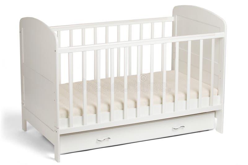 Pesebre de madera blanco del bebé en el fondo blanco fotografía de archivo libre de regalías
