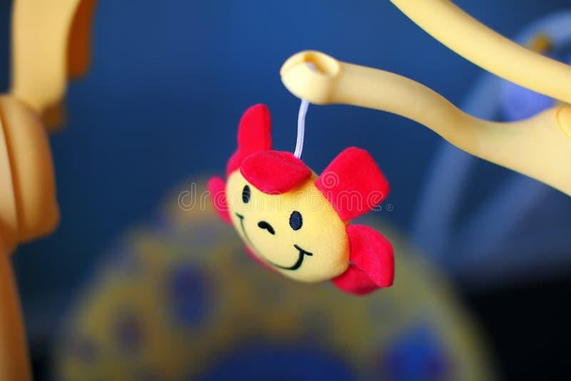 Pesebre y juguetes suaves del bebé foto de archivo libre de regalías
