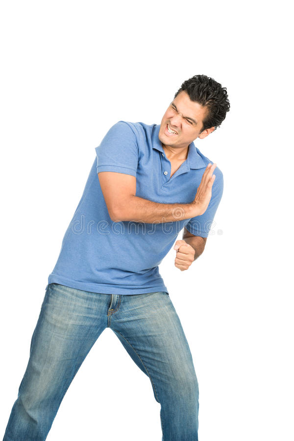 Peso corporeo dell'uomo che spinge contro l'oggetto laterale fotografia stock
