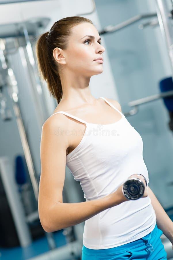 Peso do atleta fêmea fotografia de stock