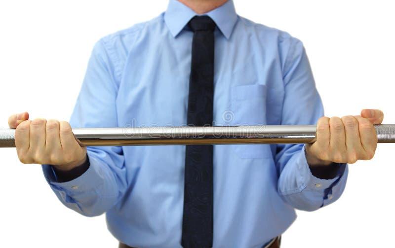 Pesos de elevación del hombre de negocios. concepto de trabajo duro y de éxito fotografía de archivo libre de regalías