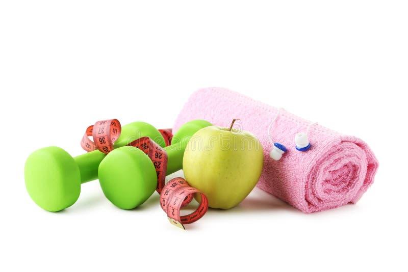 Pesos, maçã, toalha foto de stock