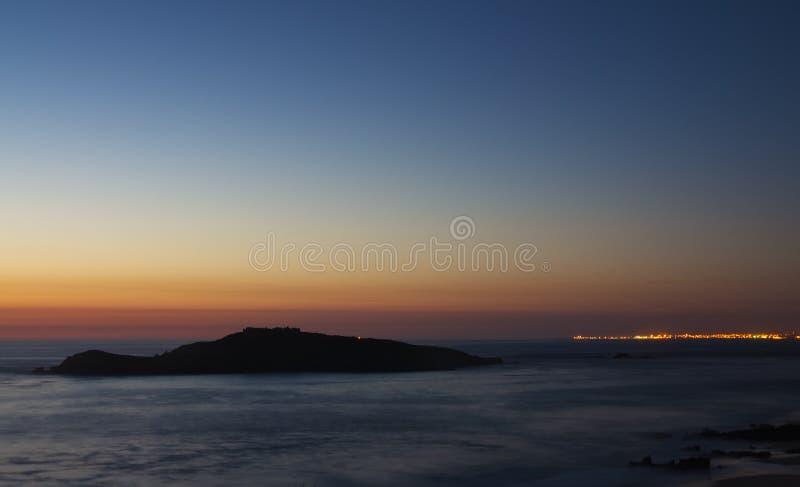 Pessegueiro Island at dusk stock photos
