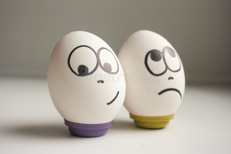 Pessimist and optimist concept. Eggs with painted face. photo for your design stock image