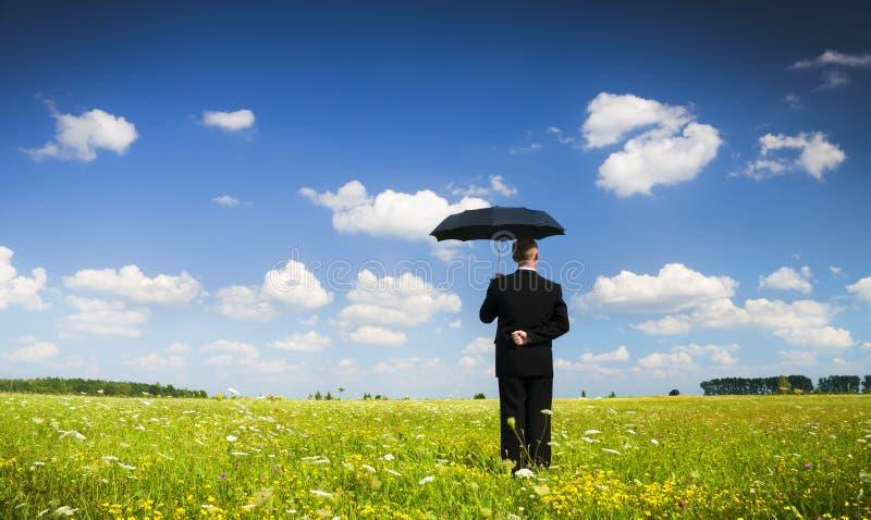 A pessoa com um guarda-chuva imagens de stock royalty free