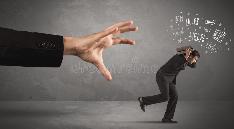 Pessoa do negócio que corre longe da mão grande imagem de stock royalty free